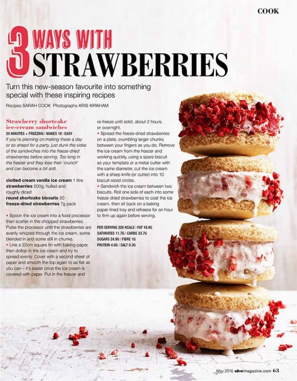 A stack of strawberry shortcake ice cream sandwiches decorated with freeze dried strawberries