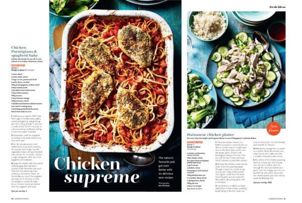 A tray bake of a chicken inspired spaghetti, showing all the pasta beneath four seasoned chicken breasts