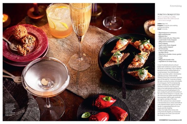 A shot showing a table top filled with porcini croquettes and different drinks to compliment