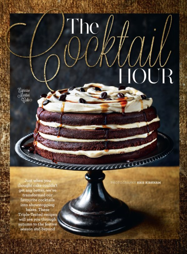A grand chocolate sponge decorated with layers of rich cream, drizzled with sauce and decorated with coffee beans